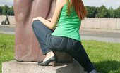Upskirt Collection Redhead girl looks great in her tight jeans on green lawn