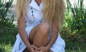 Upskirt Collection Blonde bimbo in black dress upskirt pics