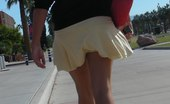 Upskirt Collection Young blonde in white mini on the street. Real upskirt