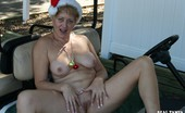 Real Tampa Swingers Happy Horny Holidays Tracy Poses Nude Outdoors On A Golf Cart In A Santa Hat