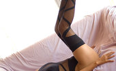 Lily Koh Black Widow NN Slender Lily Koh Shows Her Exotic Long Legs In Stockings
