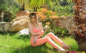 Summer St. Claire Summer In Orange Top And Jeans In The Garden