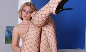 Leg Action Stephanie Richard Black Fishnets Run Up The Length Of Teen Stephanie Richard'S Long Pale Legs.