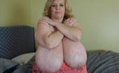 Divine Breasts Suzie 44K Sucks Her Big Boobs