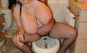 X Rated Wife Xratedwife&Amp;#039;S Big Natural 38J Tits Pop Out Of Her Fishnet One Piece As She Spreads Her Ass Cheeks.