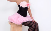 Pin-Up Wow Elle Richie In Her Tiny Pink Skirt And Black Corset Makes A Strip Only For You!