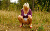 Pee Hunters Blonde With Tattooed Legs Pees Near Forest Edge