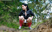 Pee Hunters Naughty Brunette Pisses Into A Sandpit In Forest