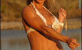 Muscularity Michelle Milgazo Ripped At Sunset As The Sun Was Setting, Michelle Put On A White And Gold, Star Sprinkled Bikini.