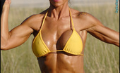 Muscularity Stephanie Erickson Lollipop And Muscles Stephanie Flew In To SLC For A Quick Afternoon Shoot. We Shot At Salt-Air Where Stephanie Works Out With An Exercise Bungee While Sucking On A Lollipop. In A Second Look, She Gets More Sultry In A Custom Made Purple Chain Link Bikini