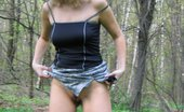 Hot Pissing 419716 Open-Air Pee Stream Blonde Girl In A Mini And A Top Decides To Make A Pee In The Open Air