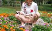Hot Pissing Flowerbed Piddling Naughty Wench Squats In The Middle Of A Flowerbed And Makes A Pee-Pee