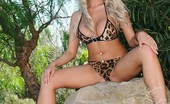 This Is Glamour Cara Brett Strips From Her Leopard Print Bikini Out In The Forest