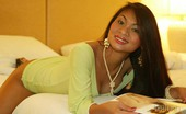 Tailynn Sexy Thai Model Stripping And Posing On A Bed