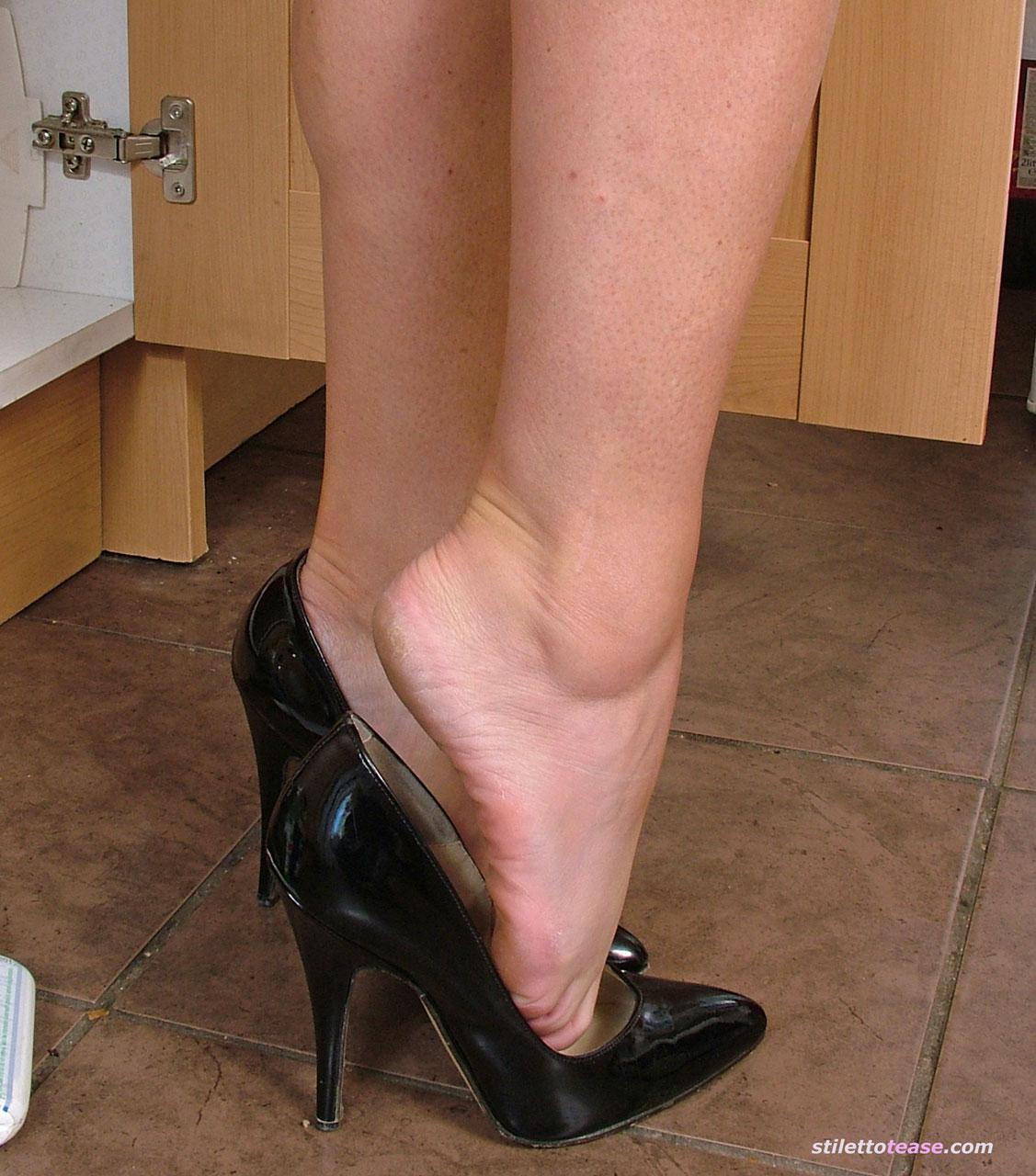 bare feet in high heels