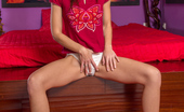 Nubiles.net Nubiles.net Minnie Magna Redhead Amateur Strips Her Mini Skirt To Show Her White Cotton Panties