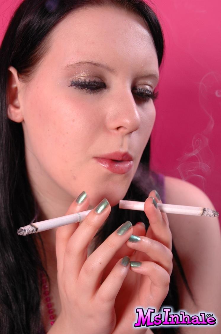 2 Girls Smoking Cigarette