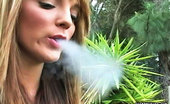Pure Smoking Exhaling Smoke 2Charlie Laine Exhales A Cloud Of Smoke Through Both Her Noise And Mouth Pure Smoking