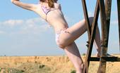 AV Erotica 475705 Natasha Skinny Small Titted Redhead Natasha Stripping On The Field AV Erotica