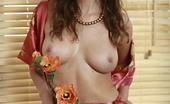 AV Erotica Eva Gorgeous Curly Babe Eva Posing Naked With Flowers AV Erotica