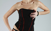 AV Erotica Sofi Redhead Babe Posing In Fancy Black Stockings And Corset AV Erotica