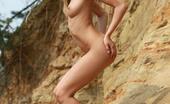 AV Erotica Sandy Beautiful Blonde Teen Sandy Posing Naked On The Sand Rock AV Erotica