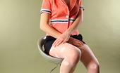 AV Erotica 476495 Adele Adele Wears Orange Top, Mini Skirt And Patterned Pantyhose For Pussy Shot AV Erotica