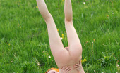 AV Erotica Kesy Attractive And Flexible Redhead Kesy Playing Nude In The Grass AV Erotica