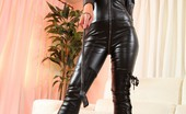 Strictly Glamour 478082 Naomi KNk Catsuit Mistress Naomi K In Leather Catsuit And Thigh-High Boots Looking Like She Means Business! Strictly Glamour