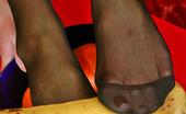 Nylon Feet Line Penelope Vivacious Babe In Black Hose Holding Fresh Banana With Her Delicious Feet Nylon Feet Line
