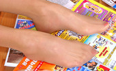 Nylon Feet Line Greta Hottie Enjoying To Turn Over The Pages With Her Delicious Feet Clad In Hose Nylon Feet Line
