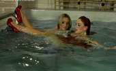 All Wam Lesbian Beauties Diving In A Large Indoor Pool For Pussy All Wam