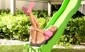 Ebina Models (XXX) Hot Teen Ember Having Fun On A Green Slide Outdoor Ebina Models