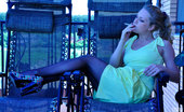 Lacy Nylons Linda Black-Stockinged Exhibitionist Smokes A Cig And Strips Naked On The Balcony Lacy Nylons