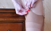 Lacy Nylons Eve Lovely Girl In A Pink Dress Attaches Fine Ultra Sheer Nylons To A Garter Lacy Nylons