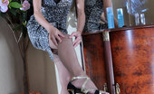 Lacy Nylons 493966 Tessa Stocking-Clad Girl Hikes Up Her Skirt By The Mirror And Fingers Her Pussy Lacy Nylons