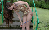 Pissing Outdoor 495921 Pissing Outdoor On Stone LadderTeen Brunette Marina Pissing Outdoor On The Stone Ladder She Has Found In An Old Park Pissing Outdoor
