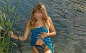 Pissing Outdoor 496013 Piss In SedgeGirl Goes Into The Lake And Piss In The Sedge Pissing Outdoor