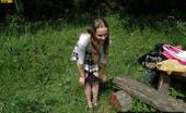 Pissing Outdoor 496023 Grass PissingGirl Pisses In The Summer Grass In A Forest Pissing Outdoor