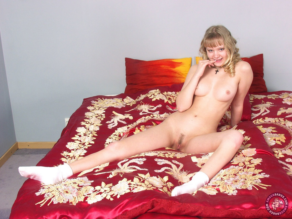 Amour Babes 501339 Lolita Young Curly Blonde Waits For Action In Bed Sexy Young Chick With A Lovely Curly Hair And Sexy Teen Body Waits For A Hard Cock To Ride Amour Babes