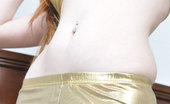 Shiny Tease Stunning Redhead Teen Kloe Poses In A Gold Outfit Shiny Tease