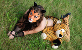 Simply Devon Devon's one sexy cat in this highly unique photo gallery that features her wearing a skimpy tiger outfit and matching face paint. It took her two hours just to paint her face! Simply Devon