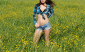 Simply Devon In this awesome summer gallery Devon finds herself outside in a lush field rife with pretty yellow flowers. She lets her country side show by sporting a cute cowboy hat! Simply Devon