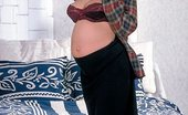 XXX Pregnant Movies 504312 Soon To Be Mom Show Off Her Enormous Belly And Spreads Her Thighs To Play With Her Cunt XXX Pregnant Movies