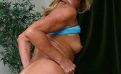 Granny Ultra Blonde GILF Gigi Playing With Her Sagged Boobs While Admiring A Huge Man Meat Live Granny Ultra