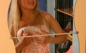 Lana's Fantasies 514033 Bad Girlie Stripping Hot Blonde Takes Off Her T-Shirt And Rubs Her Tits Lana's Fantasies