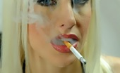 Smoking Femme Fatale Smoking A Cork Filter 120 Smoking Femme Fatale Smokes A Long Slim Rothman Royal 120 Cigarette Smoking Femme Fatale