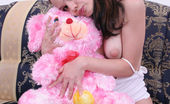 Sugar Paradise Naked Girl With Teddy BearLovely Teen Girl Seats On The Sofa With Her Pink Teddy Bear, Then She Undresses And Demonstrates Her Curvaceous Body, She Is Not A Little One Sugar Paradise