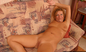 On Moms Blonde MatureBlonde Mature Strips And Shows Her Pussy On Moms