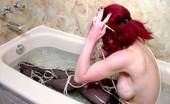 Live Voyeur Porn 552335 Sassy Redhead Enjoying Some BDSM Fun In The Tub! Live Voyeur Porn